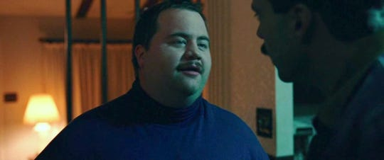 "Paul Walter Hauser and Sebastian Stan in ""I, Tonya."""
