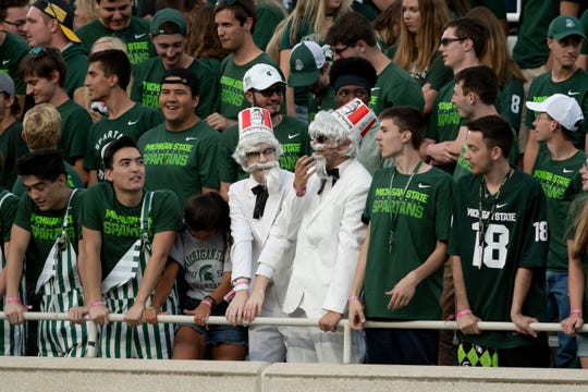 Athletic administrators at schools with high ticket demand for college football are making plans to determine who gets a seat if stadium capacities are reduced because of concerns about the coronavirus.