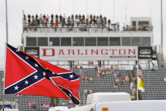 Bubba Wallace, the only African-American driver in the top tier of NASCAR, called for a ban on the Confederate flag in the sport that is deeply rooted in the South.