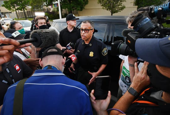 Detroit Police Chief James Craig talks with media members, explaining that due to marches being peaceful, he would not enforce the 8 p.m. curfew.