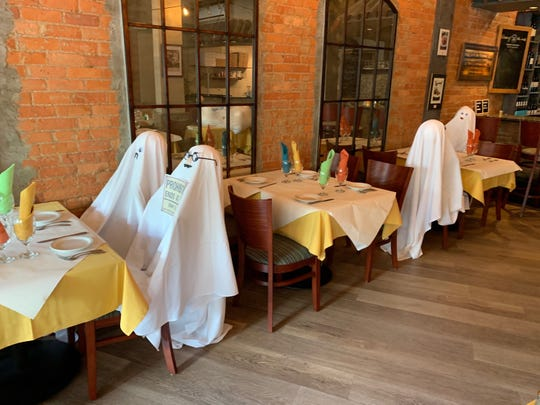 "Trattoria Da Luigi put ""ghost"" at every other table in the name of social distancing."