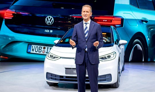 In this file photo dated Monday, Sept. 9, 2019, CEO of Volkswagen Herbert Diess introduces the new VW ID.3 at the IAA Auto Show in Frankfurt, Germany.  The German automaker Volkswagen said Monday June 8, 2020, that CEO Herbert Diess is giving up managing the company's core VW brand in order to concentrate more on the group as a whole.