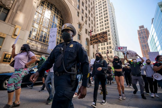 Detroit Police Commander Franklin Hayes marches with protestors through downtown Detroit on May 31, 2020, to protest the use of police brutality in the death of George Floyd.