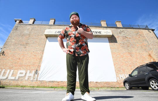 Actor Paul Walter Hauser, in front of a sign for the annual Old Saginaw City Lawn Chair Film Festival, in hometown Saginaw, Michigan on June 9, 2020.