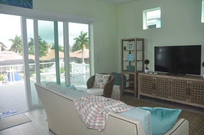 The great room in the Starfish home leads to a terrace that extends out over the water.