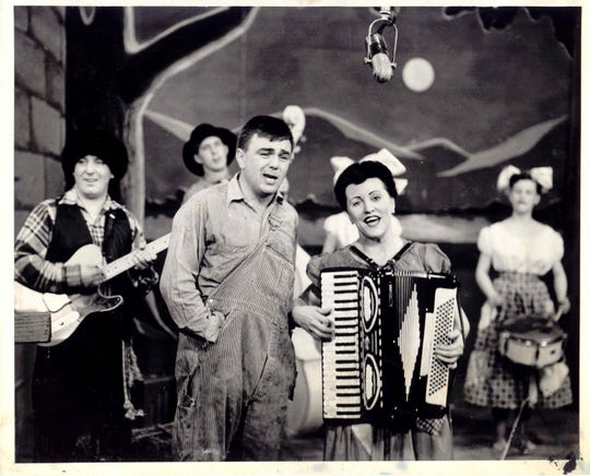 Bob Connelly and Agnes Benz lead Cousin Fuzzy and His Cousins in a song.