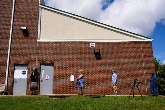 Voters wait in line to enter the West End Community Development Center and cast their ballots on primary elections day Tuesday, June 9, 2020.