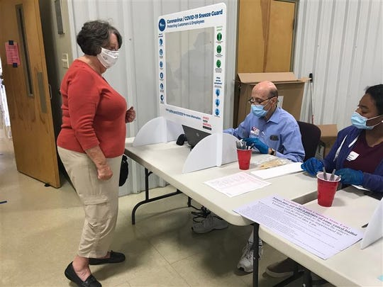 Brenda Beckley, who wore a face mask and said she has a lung condition from a blood clot, was one of about 120 voters who had made their way to Airport Baptist Church in Greenville by noon Tuesday, June 9, 2020.