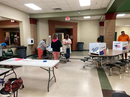 Polling begins at Easley High School, June 9, 2020. Distancing is being observed, poll workers are wearing PPE and most voters are wearing masks.