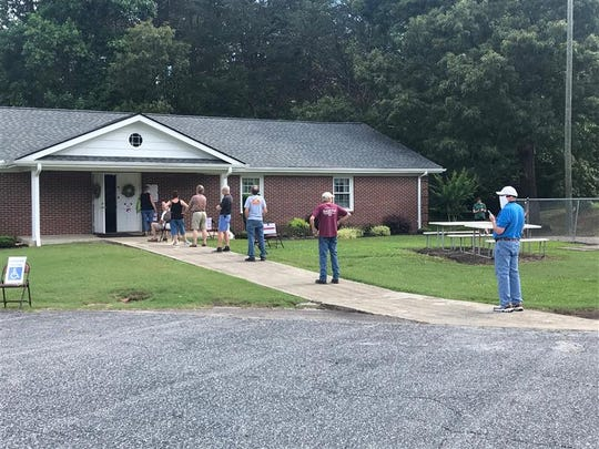 People stand in line to vote in one of Pickens County's northernmost precincts, June 9, 2020.