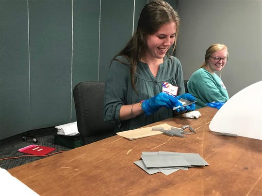 Kenzie Quinley, 18, and Maddie Buisch, 19, disinfect voting cards to prepare for incoming voters at Praise Cathedral Church of God on Brushy Creek Road in Greer, June 9, 2020. Voters are given individual disposable swabs to use on the electronic screens when casting their ballots.