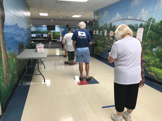 A few voters in a socially distant line forming inside Buena Vista Elementary School on Tuesday, June 9, 2020.