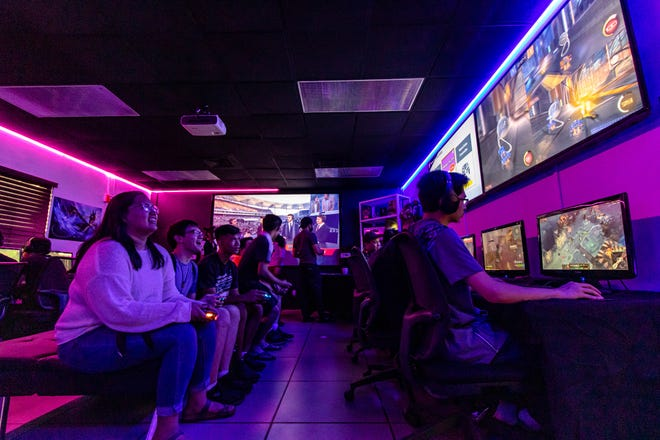 Students take a break from the heat during the University of Guam's Charter Day celebration on March 10 to play pickup games of Rocketleague and Super Smash while others compete in UOG's first ever League of Legends 1v1 duel tournament.