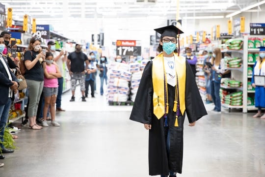 Port Barre High valedictorian Sedonia Davis is one of two Acadiana recipients of the Bill Gates Millenium Scholarship Award. Here she is recognized at Wal-Mart in Opelousas during a presentation of parish valedictorians.