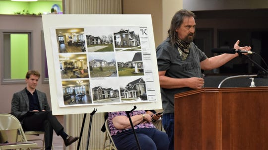 Robert Daniel, a resident of Nelson Road, expresses his concerns about a proposed apartment complex that will be built behind his property during a public hearing during Lancaster City Council's Monday meeting. The complex will have more than 200 units, with construction expected to start this summer, pending proper approval.