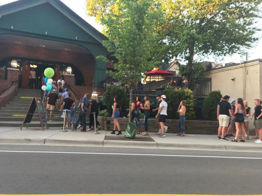 On Monday evening, June 8, people lined up outside Harper's in East Lansing.