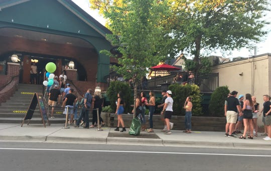 People line up outside of Harper's in East Lansing on June 8, 2020.