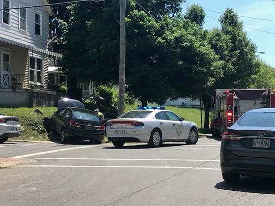 A stolen car out of Lexington was observed by a trooper from the Mansfield post Tuesday. After a pursuit, the suspect crashed the car at Adams Street and Home Avenue and ran on foot. He was apprehended thanks to the community sharing his whereabouts, Lt. Amy Ivy, commander of the Mansfield Post of the Highway Patrol, said at the scene. Lou Whitmire/News Journal