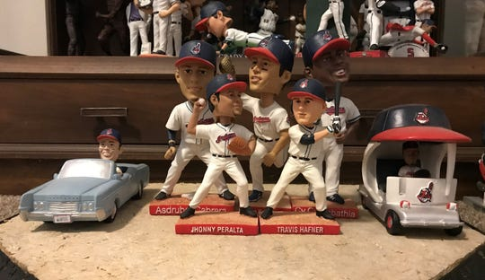 The 2008 Cleveland Indians stadium giveaway bobbleheads include two Grady Sizemores, Asdrubal Cabrera, Jhonny Peralta, Travis Hafner, CC Sabathia and Fausto Carmona in a bull pen car.