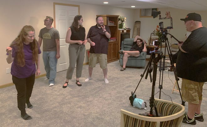 Shovel City Improv is stepping up to help support the Palace Theatre. Member Daniel Bradshaw said the group just finished producing its Basement Benefit Show, which will be released on social media at 7 p.m. on Saturday, June 13, 2020, June 13. Members of the group are shown filming a scene for the show. They are, from left, Diana Dailey, Justen LaPlante, Hannah Fuller, Eric Mosley, and Mike Cochran. Michael Bodine is filming the scene.