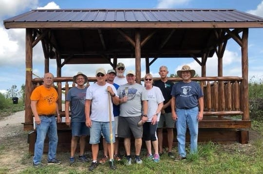Ridgedale Lions Clubs members in front of the recently completed shelter, at a lake area along Herr Road, at the Marion Tallgrass Trail.