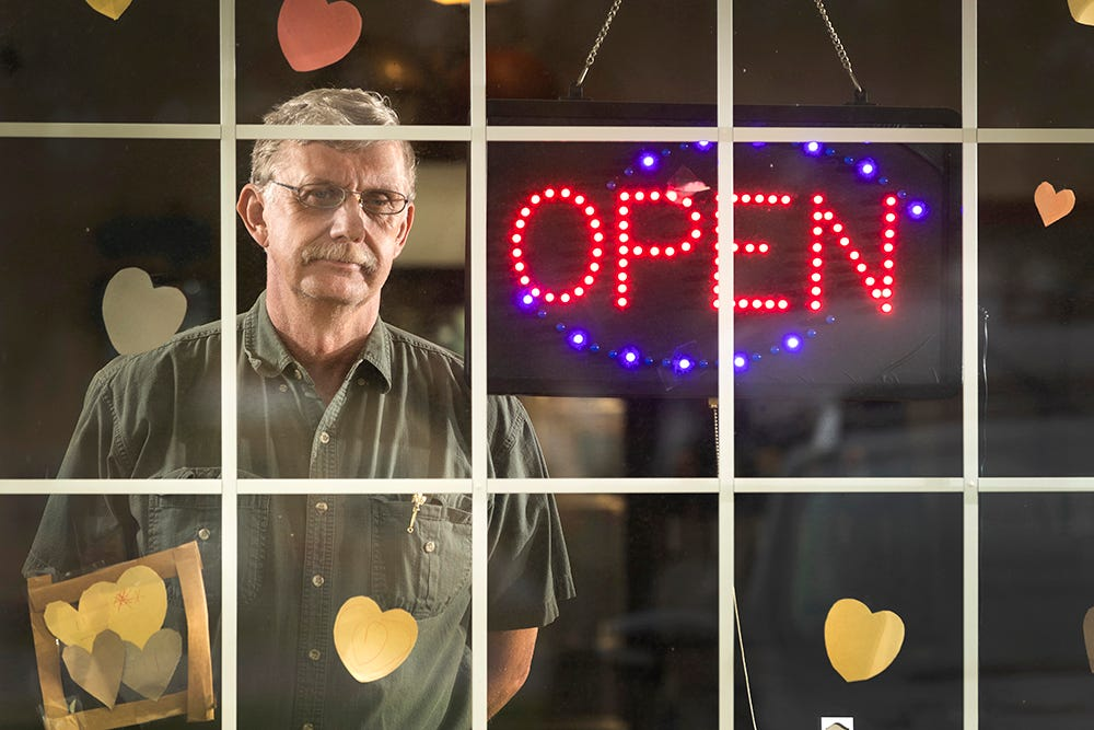 Michael Smith, owner of the Star-Lodge Motel & Grandma's Kitchen is shown Friday, May 22, 2020 in Loyal, Wis. He also owns a a bar and grill in nearby Granton.