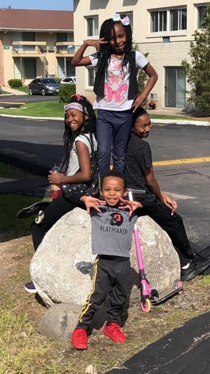 Lakeeta Watts and her husband, Ryan, have been teaching their kids, Nehemiah, LaNiyah, Aasiah and SaMyrah, about being proud of their identity during the Black Lives Matter protests.
