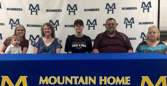Mountain Home's Brandon Weaver (middle) signed a letter of intent recently to compete in track and field at Transylvania University in Lexington, Ky. Pictured with Weaver are family members (from left) Kristen Miller, Melissa Weaver, Brent Weaver, and Freda Weaver.