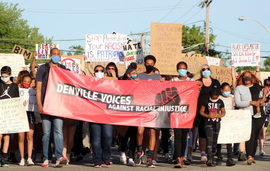 Denville Voices Against Racial Injustice, a local coalition  of about 30 residents of color march downtown with an estimated 600 people on June 8.