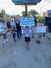 Kayla Staten, 6, marches in downtown Denville in an event sponsored by the newly formed Denville Voices Against Racial Injustice.