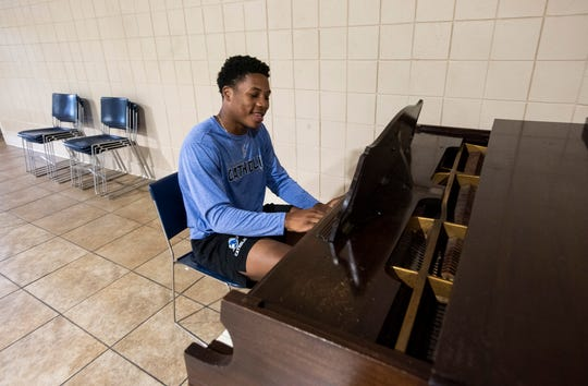 Known mostly for his tackling skills Catholic's TJ Dudley can also play piano at Montgomery Catholic High School in Montgomery, Ala., on Monday, June 8, 2020.