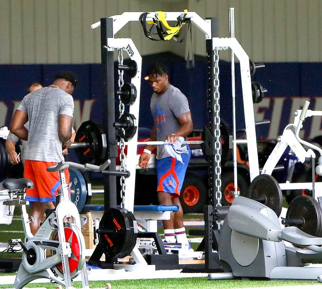University of Florida football players take part in the first day of voluntary workouts at the indoor practice facility on the UF campus in Gainesville, Fla. June 8, 2020. The team has roll-up doors on the indoor facility, which allow them to open the doors and move workout equipment close to the open doors while pairs of athletes worked out. Equipment was cleaned in between each athlete's use.
