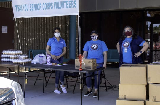 Staff at the Deming Senior Citizen's Center, 800 S. Granite Street, prepares to distribute food boxes to seniors and grandparents raising their grandchildren. From left are Monica Tovar, Alexandra Acosta and Julie Bolton.
