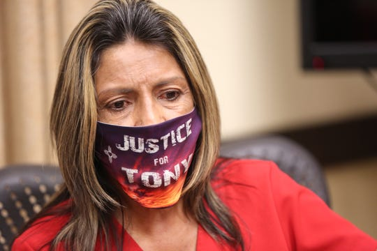 """Wearing a face mask that reads, """"Justice for Tony"""" at a news conference on Tuesday, June 6, 2020, Rosalie Valenzuela, Antonio Valenzuela's mother, said she loves her son and misses him every day."""