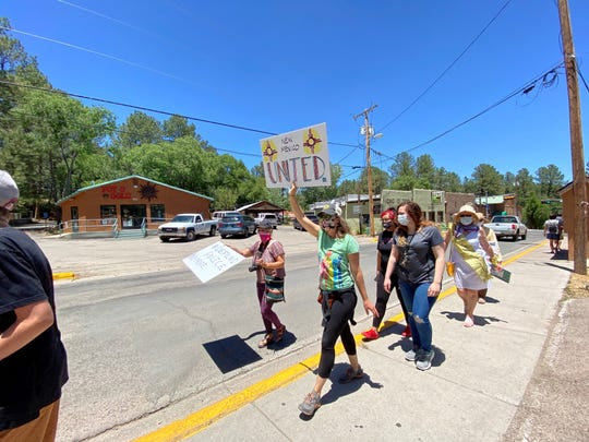 Residents of Ruidoso take a stand against racism on June 8 during the Walk for Solidarity march.