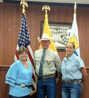 Lincoln County Sheriff-elect Michael Wood and his administrative staff Nicole Bowen, left; and Undersheriff Geraldine Martinez, right  Wood announced his team on June 9 during a special county commissioners meeting.