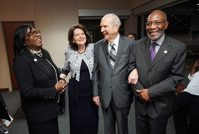 President Russell M. Nelson (center) and his wife, Wendy, are accompanied by the Rev. Theresa Dear and Rev. Amos Brown prior to President Nelson's speech at the NAACP's 110th annual national convention in Detroit on July 21, 2019.