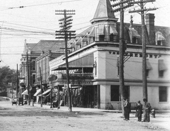 The Hotel Fremont, seen here around 1900, was one of the many downtown locations with a barber shop.