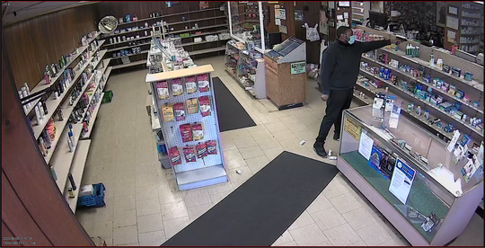 Surveillance footage from an armed robbery at Smith Street Pharmacy on Friday.