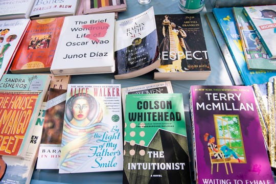 Dozens of books are laid out on a table by a Chambersburg Book Drive group during a protest at the King Street Gazebo in Shippensburg on Tuesday, June 9, 2020.