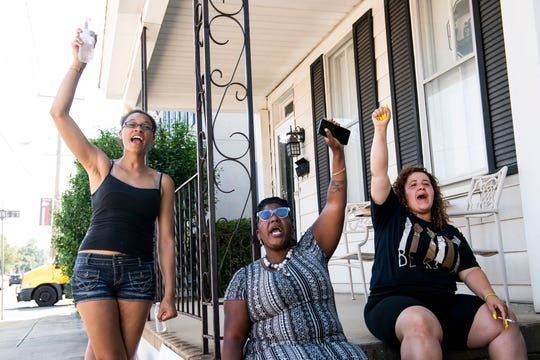 (From left) Angelisha Kirkland, Dorothy Washington and Chelsea Radabaugh join in a chant with hundreds of other protesters at a Justice for George Floyd protest at the King Street Gazebo in Shippensburg on Tuesday, June 9, 2020.
