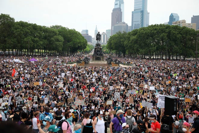 Protesters gather along the steps of the Philadelphia Art Museum and Eakins Oval  during a protest, Saturday, June 6, 2020 in Philadelphia over the death of George Floyd, a black man who was in police custody in Minneapolis. Floyd died after being restrained by Minneapolis police officers on May 25.  (Tyger Williams/The Philadelphia Inquirer via AP)