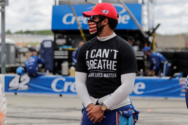 """Bubba Wallace (43) wears a """"I Can't Breath, Black Lives Matter"""" shirt before a NASCAR Cup Series auto race at Atlanta Motor Speedway, Sunday, June 7, 2020, in Hampton, Ga. (AP Photo/Brynn Anderson)"""