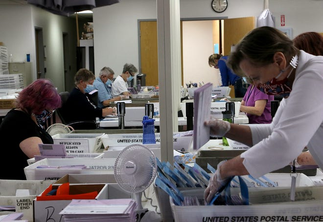 Temporary election workers sort and count mail-in ballots at the Washoe County Registrar of Voters Office in Reno on June 9, 2020.