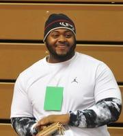 Richmond graduate Nate Trawick watches action during the IHSAA wrestling regional at Richmond High School's Tiernan Center on Saturday, Feb. 4, 2017.