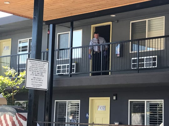 An investigator comes out of a second-floor room at the Americana Modern Hotel on June 9, 2020. Police responded to a disturbance at the motel earlier in the morning.