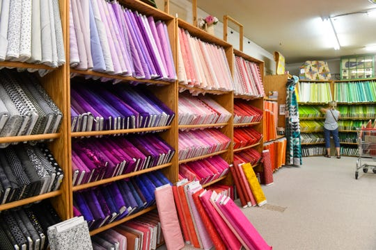 Customers choose from fabric in about every imaginable hue Tuesday, June 9, 2020, at Gruber's Quilt Shop in St. Cloud.