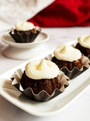 Chocolate pudding and sour cream go into these copycat Chocolate Chocolate Chip Bundtinis.