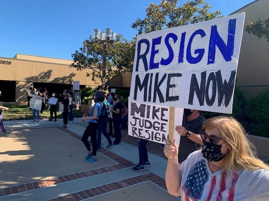 About 100 people demonstrated outside Simi Valley City Hall prior to Monday night's City Council meeting, calling for the resignation of council member Mike Judge over posts they contend are racist and misogynistic.