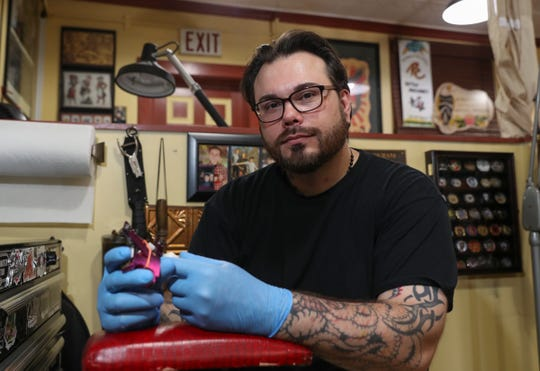 Mick O'Herien owner of Revolution Tattoo Co. in Pearl River, photographed on Tuesday, June 9, 2020.